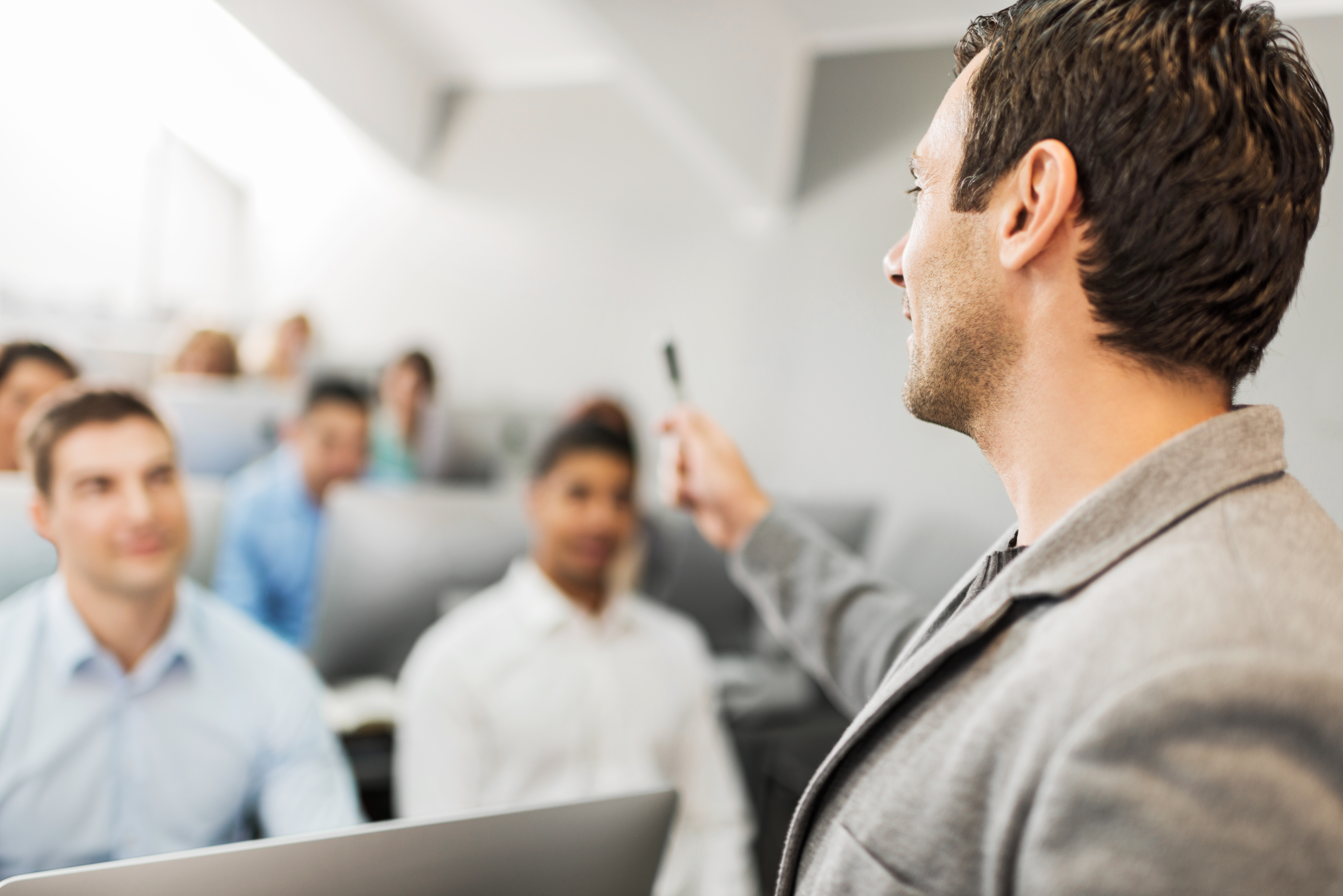 Male instructor at a business lecture.